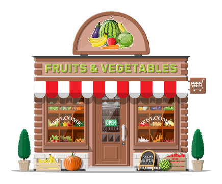 Street brick shop building exterior. Fruit and vegetable store facade. Fresh organic food products. Cucumber tomato pumpkin garlic onion carrot corn pepper banana. Vector illustration in flat style