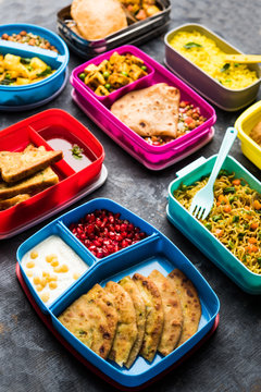 group of Lunch Box / Tiffin for Indian kids, showing variety or multiple option or combination of healthy food for your school going children