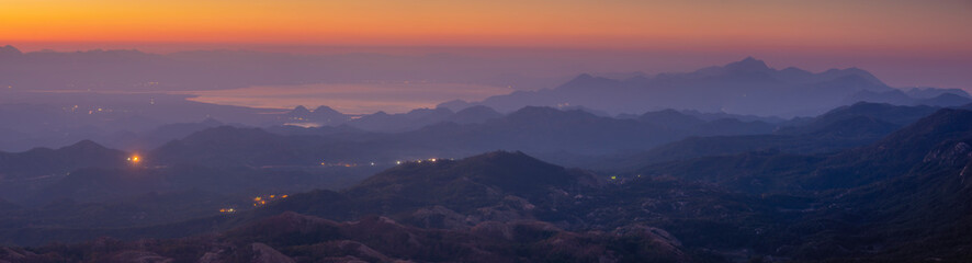 Panorama of Skadar Lake in Montenegro during sunrise on a beautiful foggy morning. Visible mountains surrounding the lake