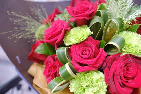 Macro view of colorful blue red green white pink purple rose flower bouquet in full blossom