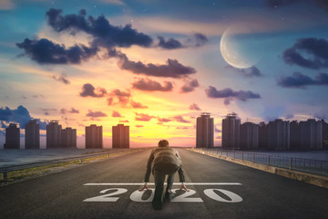 Businessman starting road to success 2020. Elements of this image furnished by NASA. Fotomurales