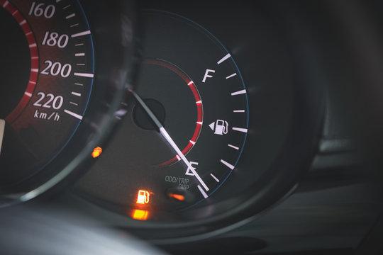 Low Fuel gauge showing fuel dashboard.