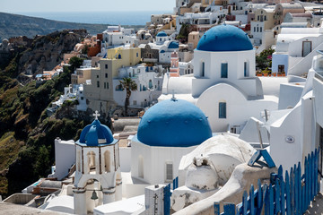 Three Blue Domes church Santorini Oia village in Santorini island, Greece.