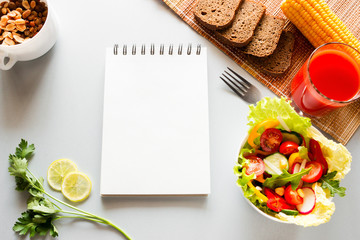 vegetables and notebook with place for text concept diet, diet food