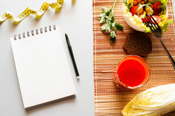 diet sports nutrition for weight loss and notepad with place for text