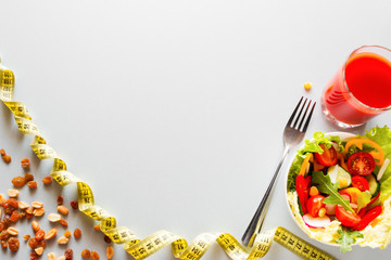 diet food and measuring tape with place for text on a white background concept slimming and healthy lifestyle