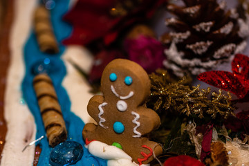 Christmas decorations against blurred background. Happy gingerbread man.