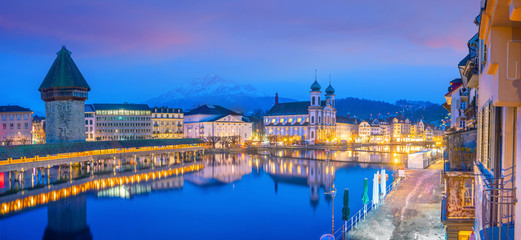 Historic city center of downtown Lucerne with  Chapel Bridge and lake Lucerne in Switzerland Wall mural