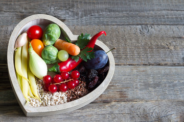 Healthy food in heart diet concept on vintage boards