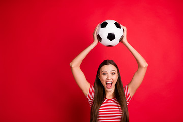 Photo of cheerful cute nice beautiful excited ecstatic screaming trendy girlfriend wearing striped t-shirt jeans denim team play while isolated with red background