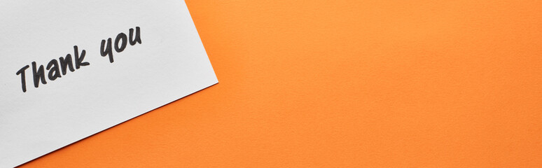 top view of thank you card on orange background, panoramic shot