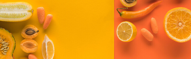 top view of yellow fruits and vegetables on orange background with copy space, panoramic shot