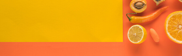 top view of yellow fruits and vegetables on orange background with copy space, panoramic shot Wall mural