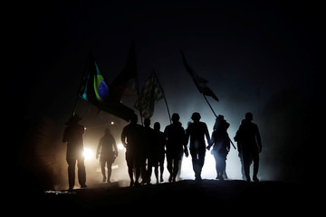 Members of the Free Brazil Movement walk during a protest asking for asphalting for the road on BR-319 highway near city of Humaita