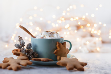Hot winter drink: chocolate with whipped cream in blue mug. Christmas time. Cozy home atmosphere,...