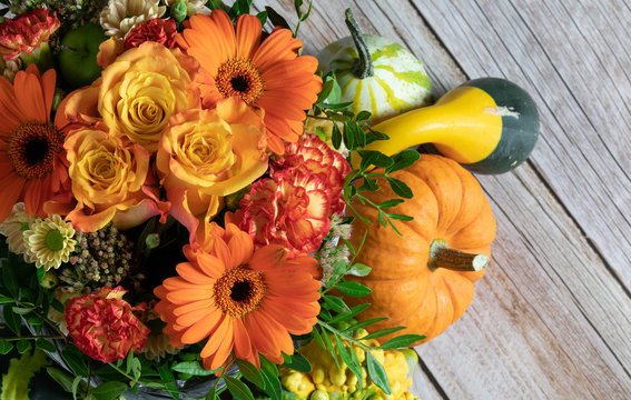 Wooden Table. Flowers. Colours. Fall. Pumpkins. Deco