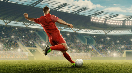 Soccer player in action. Run with a ball. Soccer stadium with cheering fans