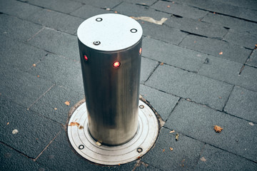 bollards can be retracted into the roadway to allow traffic
