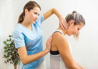 A Modern rehabilitation physiotherapist at work with client