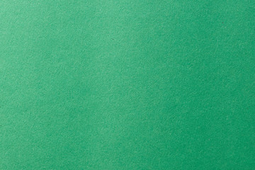Clean green paper texture with simple surface. High resolution photo. Color paper, light green paper. Empty green paper backgrounds.