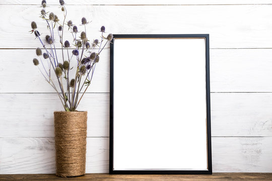 Black picture frame with decor