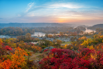 Foto op Canvas Landschappen beautiful autumn landscape with colorful trees and foggy river on sunset