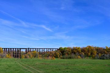train trestle with trees and blue sky