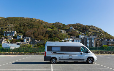 Wall Mural - Motorhome parked in car park Snowdonia National Park Barmouth Wales, beautiful coast town in Gwynedd with mountains