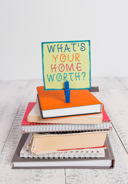 Word writing text What S Your Home Worth Question. Business photo showcasing Value of a house Property Cost Price Rate pile stacked books notebook pin clothespin colored reminder white wooden