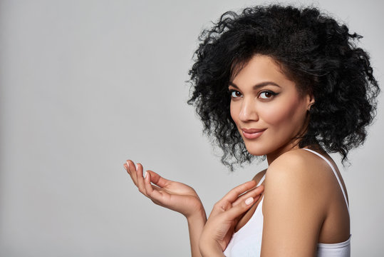 Beautiful mixed race woman with opened palm looking at camera