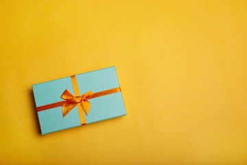 Christmas gift box on yellow background flat lay