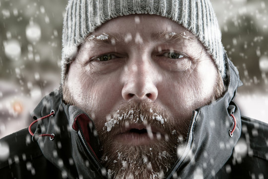 Man in snow storm close up