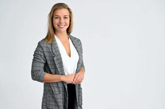 Close-up portrait of a cute caucasian blonde female student girl in a gray jacket on a white background. Wide smile, happiness. It is in different poses.