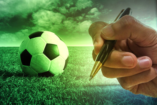 Football with football player hand to sign contract , soccer journalist