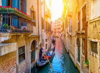Foto auf Leinwand Venedig Narrow canal with gondola and bridge in Venice, Italy. Architecture and landmark of Venice. Cozy cityscape of Venice.