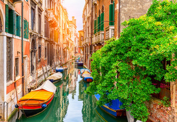 Aluminium Prints Venice Narrow canal with boat and bridge in Venice, Italy. Architecture and landmark of Venice. Cozy cityscape of Venice.