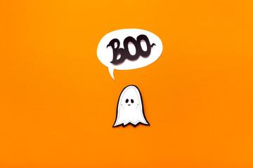 Ghost kid saying boo on orange Halloween background