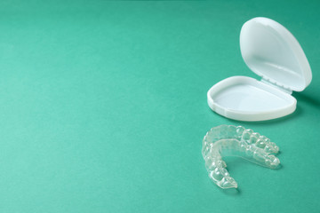 Plastic mouthguard for teeth whitening on a green background