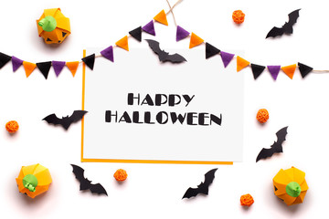 Happy Halloween text on white sheet of paper