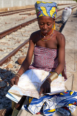 Ndengelengo woman checking map at train station