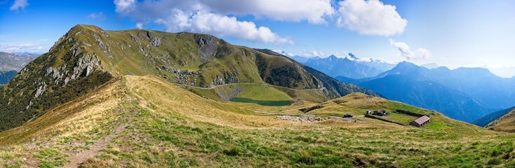 Mountain panorama with blue sky and clouds. Alps Italy. Friuli.