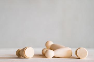 Fotobehang wooden dolls stumble on the table