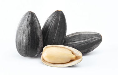 Close-up of delicious sunflower black seeds, isolated on white background