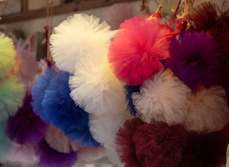 Puffs of tulle produced from textile products.