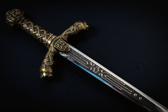 Knight sword on a black background