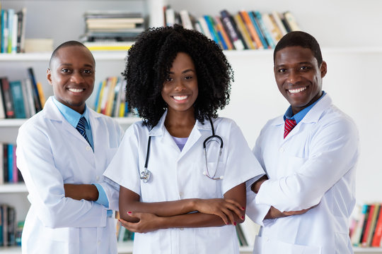 General practitioner and doctor and nurse as african american medical team