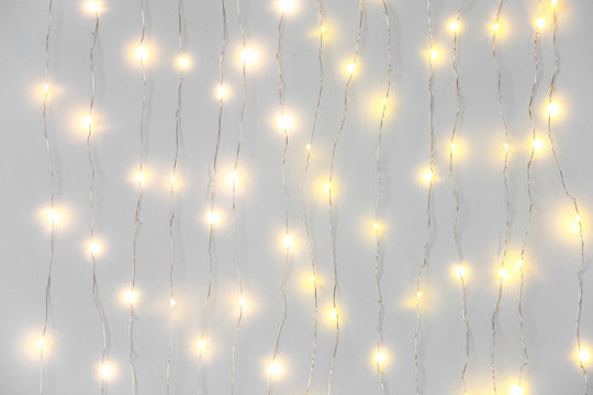 Beautiful Christmas lights on white background