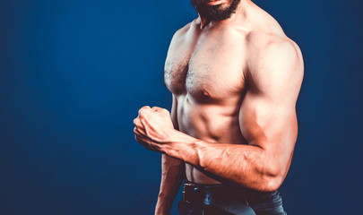 Bodybuilding banner with cropped image of bodybuilder athlete flexing biceps. Fitness template with copy space.