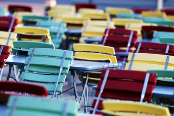 Colorful outdoor cafe chairs and tables