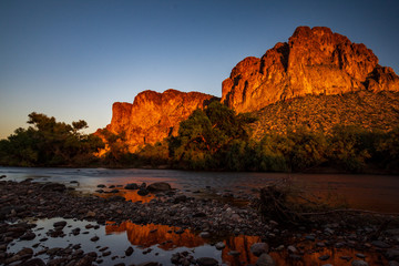 Sunset reflecting on cliffs along Salt River in Arizona